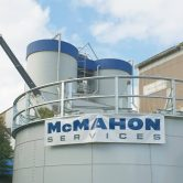 McMahon Services banner on steel silo at Port Kembla