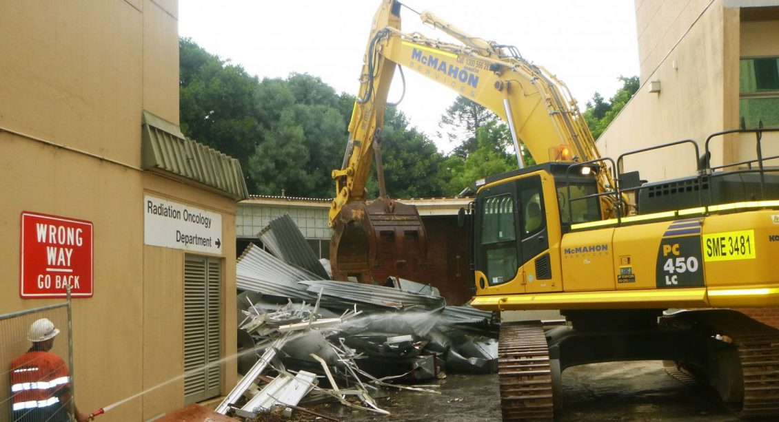 McMahon Services Excavator demolishing building at Lot Fourteen Demolition Site of the Old Royal Adelaide Hospital