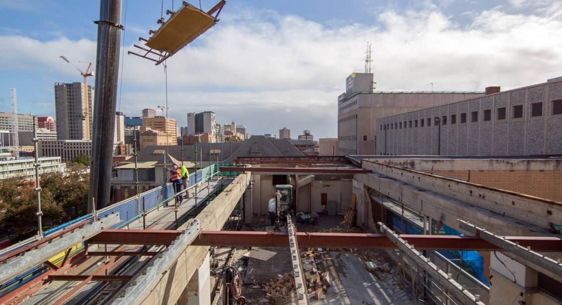 View into roof of building with McMahon Services workers at Lot Fourteen Demolition Site of the Old Royal Adelaide Hospital
