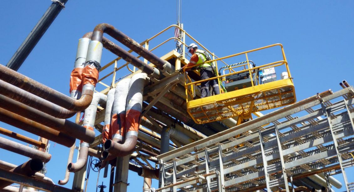 Man on lifter platform during Thermofor Catalytic Cracker Feed Preparation and Tower Deconstruction