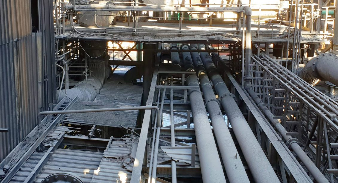 Pipes between buildings at Nyrstar's Port Pirie Smelter